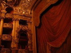 The Palais Garnier, also known as the Opéra de Paris or Opéra Garnier. ....Balconies and the trompe d'oeil curtain ~ the interior of the auditorium is lined with gilded boxes on the dress circle and balcony levels.