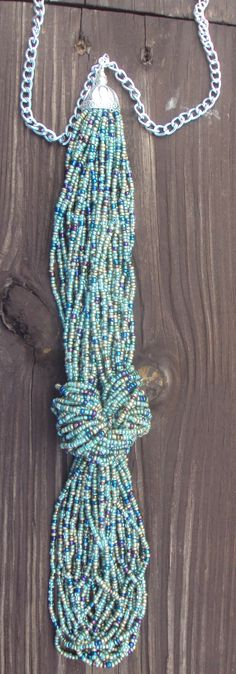 Hey, I found this really awesome Etsy listing at http://www.etsy.com/listing/175578933/knotted-seed-bead-tie-style-long