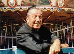Walt Disney in front of the King Arthur Carousel in Disneyland's Fantasyland. About 1966.