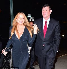 So happy: Mariah flashed her new $7.5m diamond sparkler as she and James celebrated their ...
