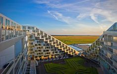 8 Tallet (8 House), by Bjarke Ingels Group. 426 apartments in a green-roof community complex. Denmark