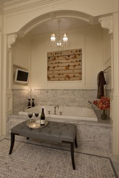 So I hate that shade, the flooring, that particular marble pattern, the brown towel...but that molding just makes this space. I'm a fan of baths recessed into decorative alcoves. Take note, dear home builders!