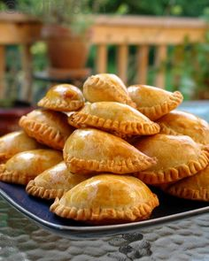 Empanadas mendocinas are traditional Argentinean baked empanadas filled with beef, onions, paprika, hot pepper powder, cumin, oregano, hard-boiled egg and olives.....