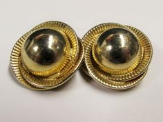 """Vintage Gold Tone Ball and Swirl Clip on Earrings.  These gold tone earrings are a reflective ball with textured gold swirling rings around them.  The earrings are approx. 7/8"""".  They are in good vintage condition with little wear."""