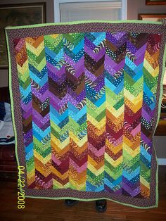 rainbow braid jelly roll quilt by aleshapie, via Flickr