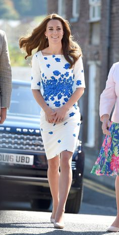 August 24, 2016 - The Duchess wears a chic blue and white floral dress by L.K. Bennett with a nude clutch and matching heels while visiting the Youthscape Center in Luton with Prince William.