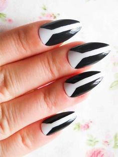 Stunning ideas of nail art designs for women to sport in 2018. We've collected here a long list of fresh black and white almond shaped acrylic nail arts and images to use in year 2018. So keep visiting here to see more modern trends of nails.