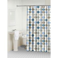 Brighten your bathroom with a new shower curtain. Light and dark blue and gray polka dots resemble cheerful bubbles on this polyester shower curtain. Its machine-washable, so its easy to clean and will remain fresh throughout its long life.
