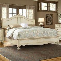 """Lend elegant appeal to your master suite with this eye-catching bed, showcasing carved accents and an antiqued white finish.   Product: BedConstruction Material: Mahogany wood and wood Color: Antiqued whiteFeatures: Turned feetSimulated shell carvingsArched headboardScalloped footboardDimensions: Queen: 62"""" H x 69"""" W x 95"""" D King: 62"""" H x 85"""" W x 95"""" D"""