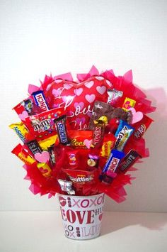 A handmade arrangement of your favorite candy in a pink heart tin. A great gift for Valentine's Day . Arrangement contains a mix of candy including Kit Kat, Skittles, Twix, Variety of M&Ms, Almond Joy Valentines Day Treats, Valentines Day Decorations, Valentine Day Love, Valentine Day Crafts, Valentine Ideas, Guys Valentines Gifts, Secret Valentine, San Valentin Ideas, Valentine Baskets
