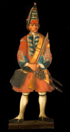 """1738 British Dummy board of a grenadier at the National Army Museum, London - From the curators' comments: """"Life-size, cut-out figures painted on wood, often called dummy boards, were fashionable in grand houses in the eighteenth century. They were a sort of decorative joke designed to surprise visitors. Standing at the end of a passage or in the corner of a room, a dummy board would look, at first sight, like a real person."""""""