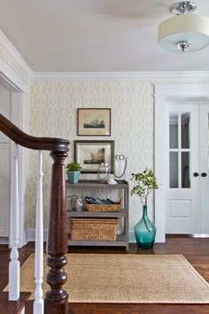 A small entryway means you can get away with a bold accent wall. Patterned wallpaper adds definition to a meager foyer and yields instant personality that might overwhelm anywhere else.