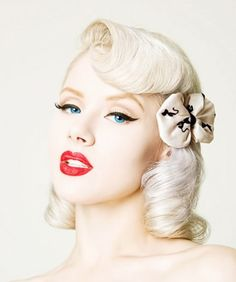 An easy Halloween costume is a bombshell pinup, complete with curls, red lipstick and winged eyeliner
