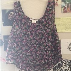 Flower tank! This tank top is from Charlotte Russe. Only worn a few times. Flirty and fun!! Charlotte Russe Tops Tank Tops