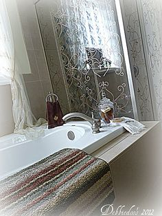 Stenciled glass shower door, using Stencil Ease's French Iron Wall and Floor Stencil