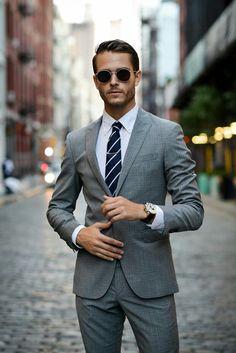 Adam Gallagher in gray suit
