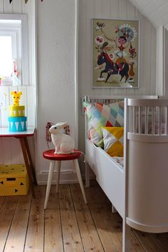 the boo and the boy: eclectic kids' rooms :: love the curves in the bed