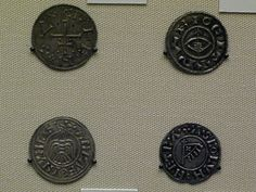 Viking coins minted in York, Yorkshire, England. The designs include Christian and Heathen symbols, a bow and arrow, a raven (a battle symbol associated with Odin), a cross and a battle standard bearing a cross. From the collection at the British Museum, London.