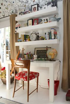 Crazy for this room:  desk, wallpaper, desk chair; shelves (thick); shelf styling; red accents; white floor (the best)