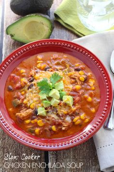 Slow Cooker Chicken Enchilada Soup - a warm and comforting meal perfect for the weeknight! Let dinner cook in your slow cooker and come home to a flavorful meal!