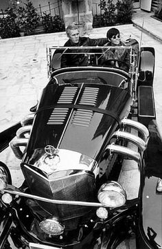 Steve McQueen and his 1st wife, Neile, in her Excalibur, 1970.