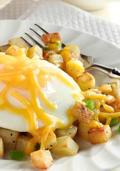 Country Morning Skillet — Skillet-sauteed potatoes, peppers and onions give this cheesy egg recipe terrific flavor.