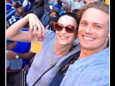 Outlander Stars Sam Heughan and Caitriona Balfe Cuddle Up at Rugby ...