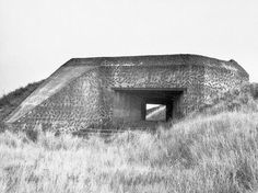 The smooth embrasure signifies that the fortification will get armor plating. The inclined mass, existing in each bunker, serves to screen it and to mark the cannons blind spot.