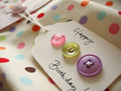 sweet, easy little tag made with buttons.  Love it on the polka dot paper.