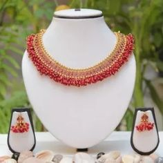Buy Golden Traditional Pink Lariya necklace set Online