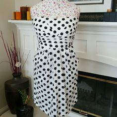 Polka Dot Dress Black and white strapless dress bought from Papaya zippered back w/pockets. Has tiny rip at the end of the zipper but barely noticeable and some discoloration at top (see 4th pic) but I use to pair it with a red cardigan and it was not noticeable. Papaya Dresses Strapless