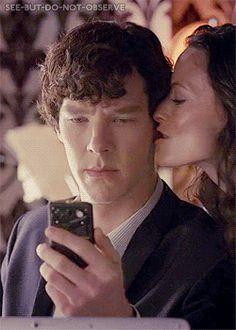 Sherlock & Irene.  I like this gif simply for the way his eyes glance over for just a second before he goes back to his phone.  He's going did she just KISS me?!!?
