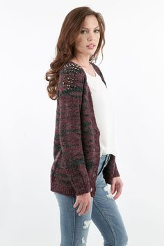 Free Shipping on All U.S. Orders. Show off your soft side, with a little bit of punk.  Our oversized burgundy and gray pattern sweater cardigan made by Prima Collection features stud shoulder accent, front pockets, and 5 wood button closures.  Made of wool, this stylish cardigan will keep you nice and warm while not making you itchy (because it is SUPER soft)! #cardigan