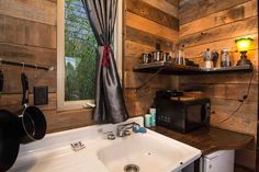 A 160 square feet tiny house on wheels built from salvaged materials in Portland, Oregon. Built by Eric Bohne.