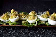CAESAR SALAD DEVILED EGGS - These eggs are a perfect example. The standard, old-school deviled eggs gets a little help from the ingredients in great caesar salad.
