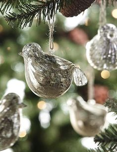 These vintage mercury glass bird ornaments will be the talk of your tree. HomeDecorators.com mercuri glass, mercury glass, vintage birds, bird ornament, vintage silver, glass ornaments, glass bird, christmas trees, christmas tree ornaments