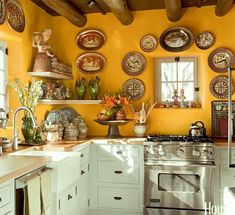 mexican-plate-kitchen - Benjamin Moore hc-7 - bryant gold - orange walls - via house beautiful