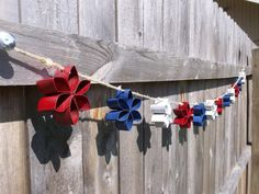 The Thriftiness Miss: Patriotic Toilet Paper Roll Garland Holiday Crafts, Holiday Fun, Fun Crafts, Crafts For Kids, Paper Crafts, Toilet Paper Roll Art, Rolled Paper Art, Fourth Of July, 4th Of July Wreath