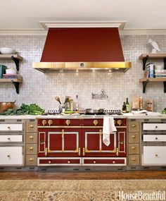 """Designers Carey Maloney and Hermes Mallea created a vibrant kitchen in a New York town house. The Burgundy La Cornue Chateau 150 range is the kitchen's focal point and showstopper. """"Everything else recedes into the background,"""" Maloney says. """"I mean look at that stove doing its thing — you don't need any more statements."""""""