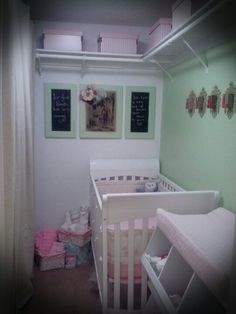 Walk-in closet/ Nursery. In half of the closet, the parents clothes are hidden by a full length curtain. The other half, shelving taken down, painted, & converted into nursery. Done on a tight budget!