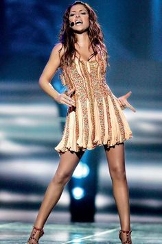 Here in Eurovision 2005 sings ''My number one'' that came first in the competition! Helena wears Roberto Cavalli dress with swarovski Eurovision Greece, Stage Outfits, Cool Outfits, Helena Paparizou, Pretty People, Beautiful People, Very Beautiful Woman, Greek Music, Music