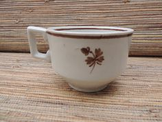 Check out this item in my Etsy shop https://www.etsy.com/listing/470191921/antique-brown-tea-leaf-ironstone-cup
