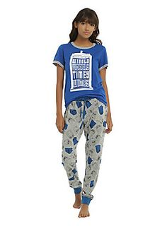 """<div>What better outfit to wear during your<i>Doctor Who</i>binge watch session than this TARDIS sleep set? The bright blue short sleeve shirt has heather grey ringer details and a TARDIS print with text design that reads """"Wibbly Wobbly Timey Wimey."""" The heather grey joggers have a bright blue elastic and drawstring waistband, bright blue elastic cuffs and an allover TARDIS print.</div><div><ul><li style=""""list-style-position: outside !important; list-style-type: disc !impor..."""