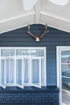 Kyal and Kara's outdoor deck reveal on Toowoon Bay Reno using Wideline windows and doors. www.wideline.com.au