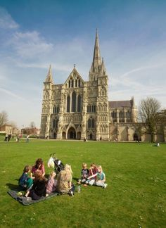 A family picnic in the Close in front of Salisbury Cathedral