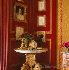Alidad ~ The master bedroom has a damask-covered corner screen on which is displayed a collection of framed artwork