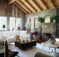 Barn turned home. Love the ceiling (want to do this in my living room) and the HUGE antlers. Cozy cozy and so elegant!