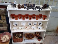 Outdoor maths station- plant pots are cool idea, could be heavy plastic filled with maths equipment