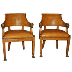 Love these tooled leather Maitland Smith Armchairs. They have a super chic look that is very high fashion for your living room or home office. Oh so chic!