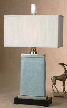 One Light Table Lamp This lamp has a light blue crackle porcelain body and nickel plated accents, and is topped nicely with a rectangular, ivory textile shade.